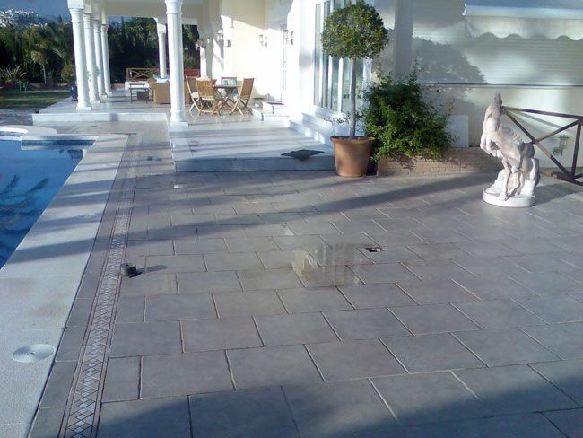Fotos slipfree tratamiento antideslizante para suelos for Suelos antideslizantes para piscinas